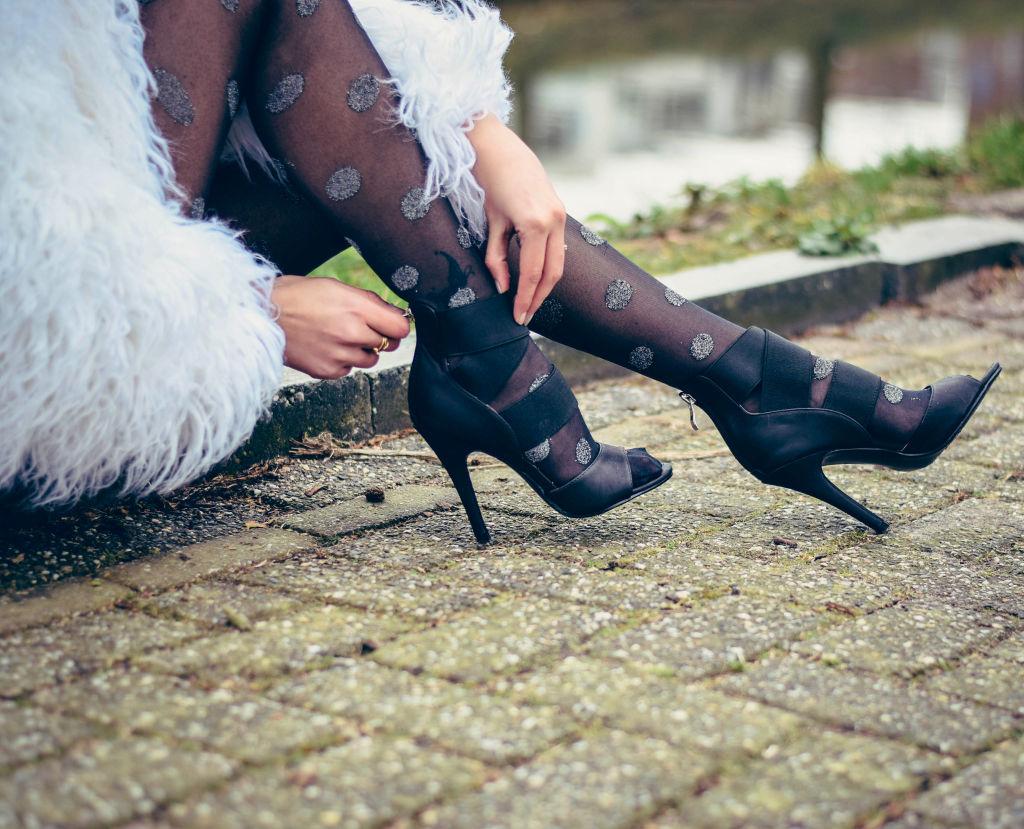fur jacket stockings stilettoes